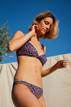 woman wearing a two-piece swimsuit graffiti face