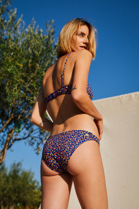 woman wearing a two-piece swimsuit graffiti back