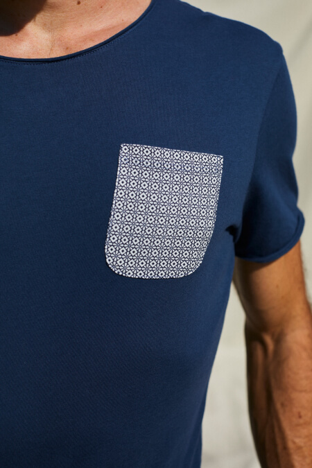 man wearing a navy t-shirt with azulejos pocket