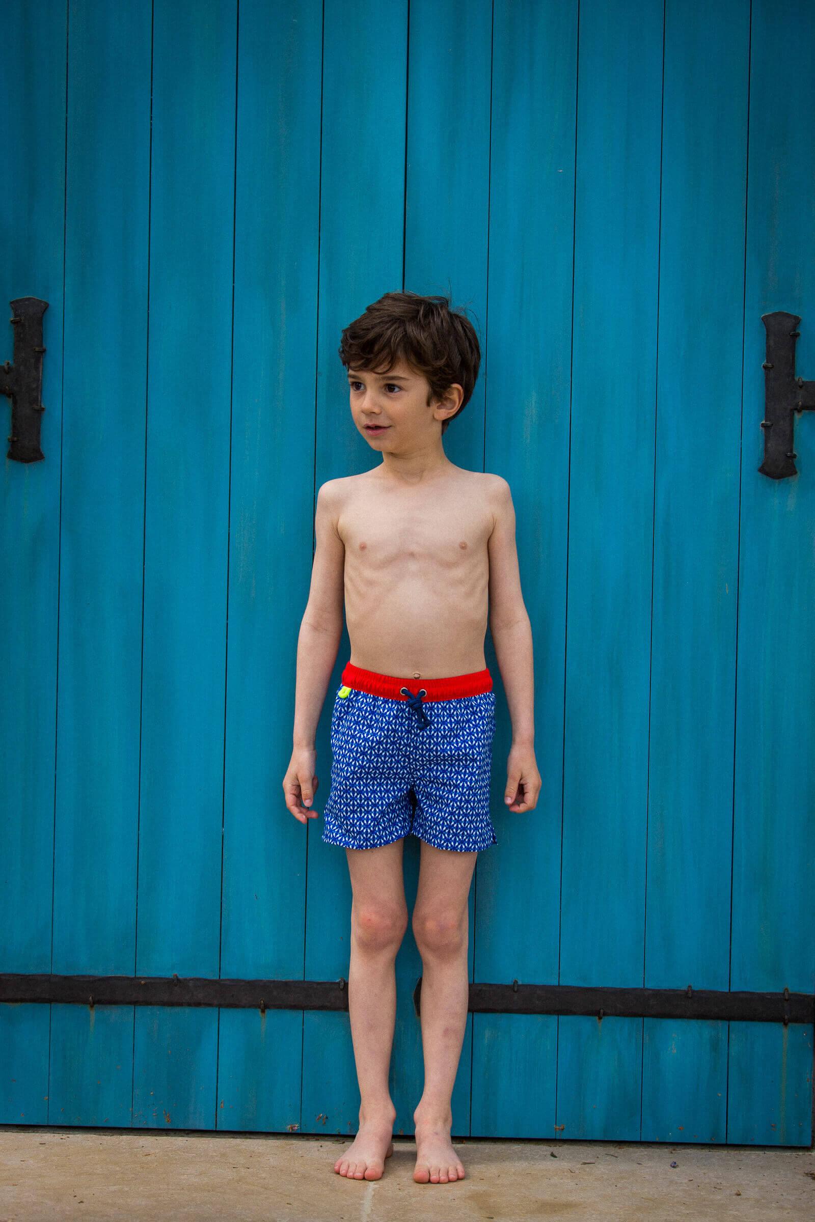 Boy wearing a Navy Kangaroos swimsuit