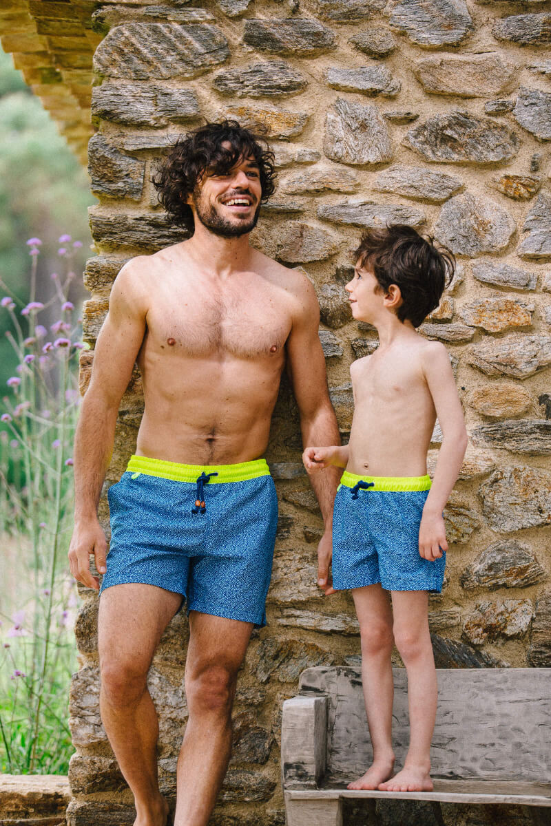 Boy wearing a swimsuit with elasticated belt Meno Sunny Atolls
