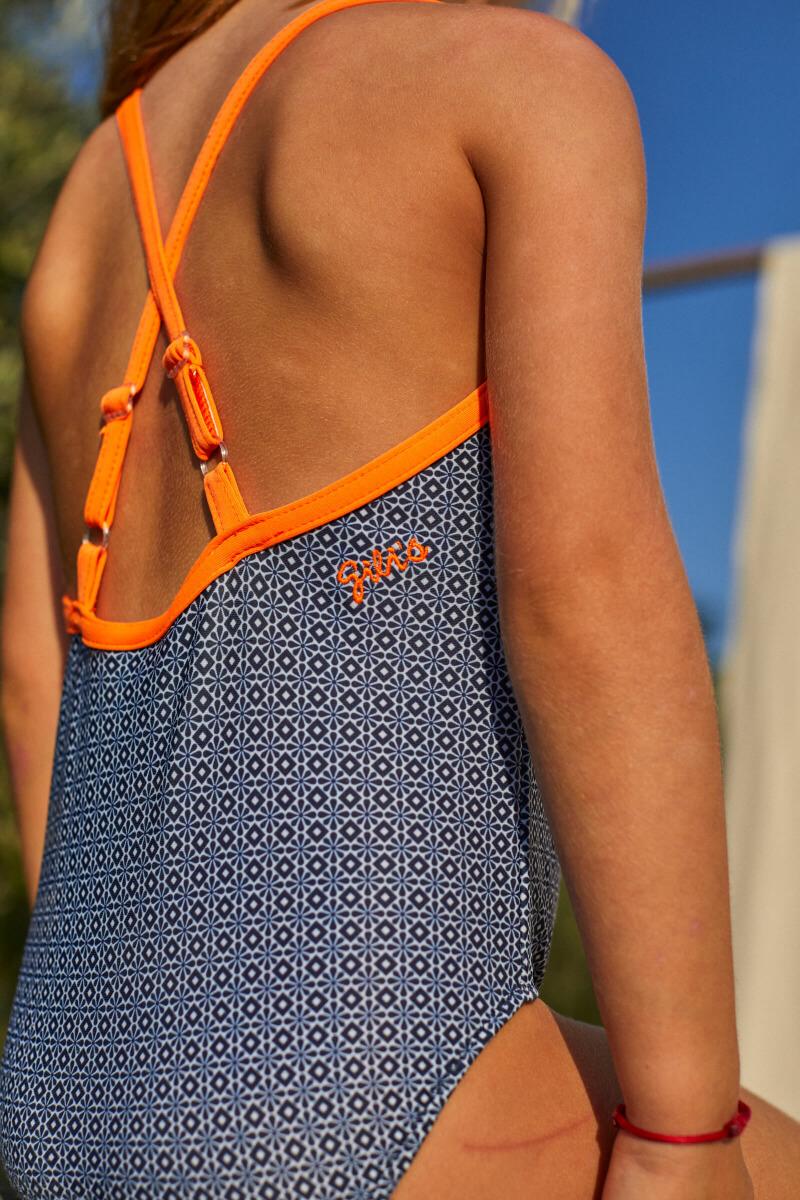 Girl wearing a one-piece swimsuit Navy Pop Azulejos