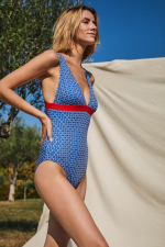 Woman wearing a one-piece swimsuit navy kangaroos