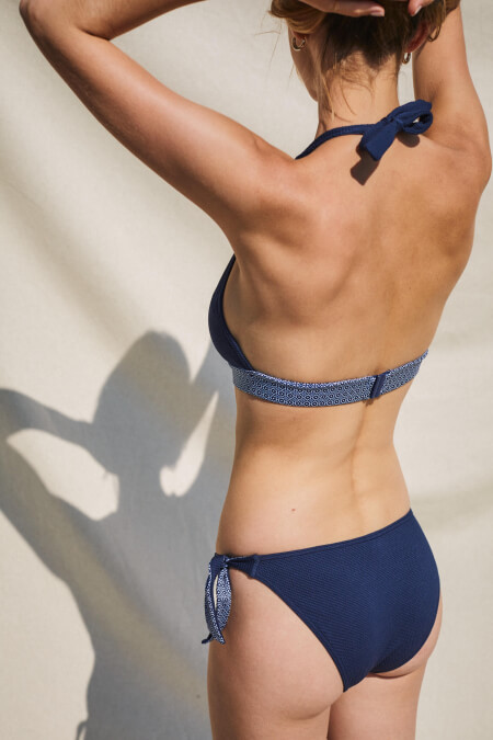 woman wearing a two-piece swimsuit navy azulejos