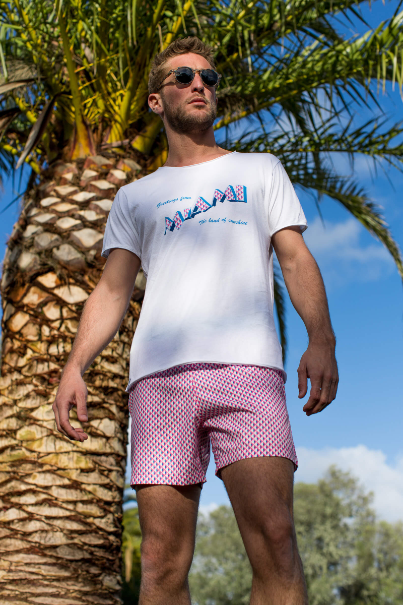 Man wearing a Miami Beach swimsuit with elasticated belt