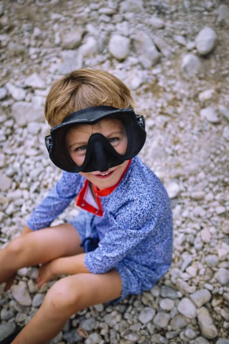 Kid wearing a Off the Coast anti UV t-shirt