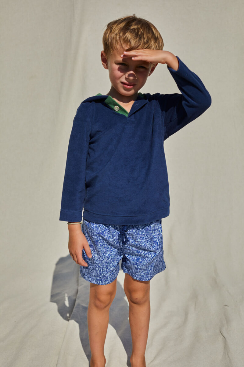 kid wearing a navy terry cloth sweat
