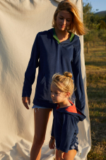 woman wearing a navy terry cloth sweat