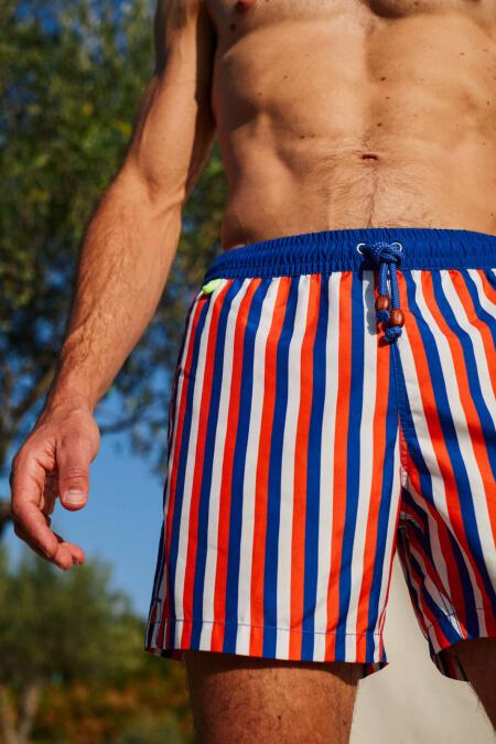Man wearing a La Baule swimsuit with elasticated belt