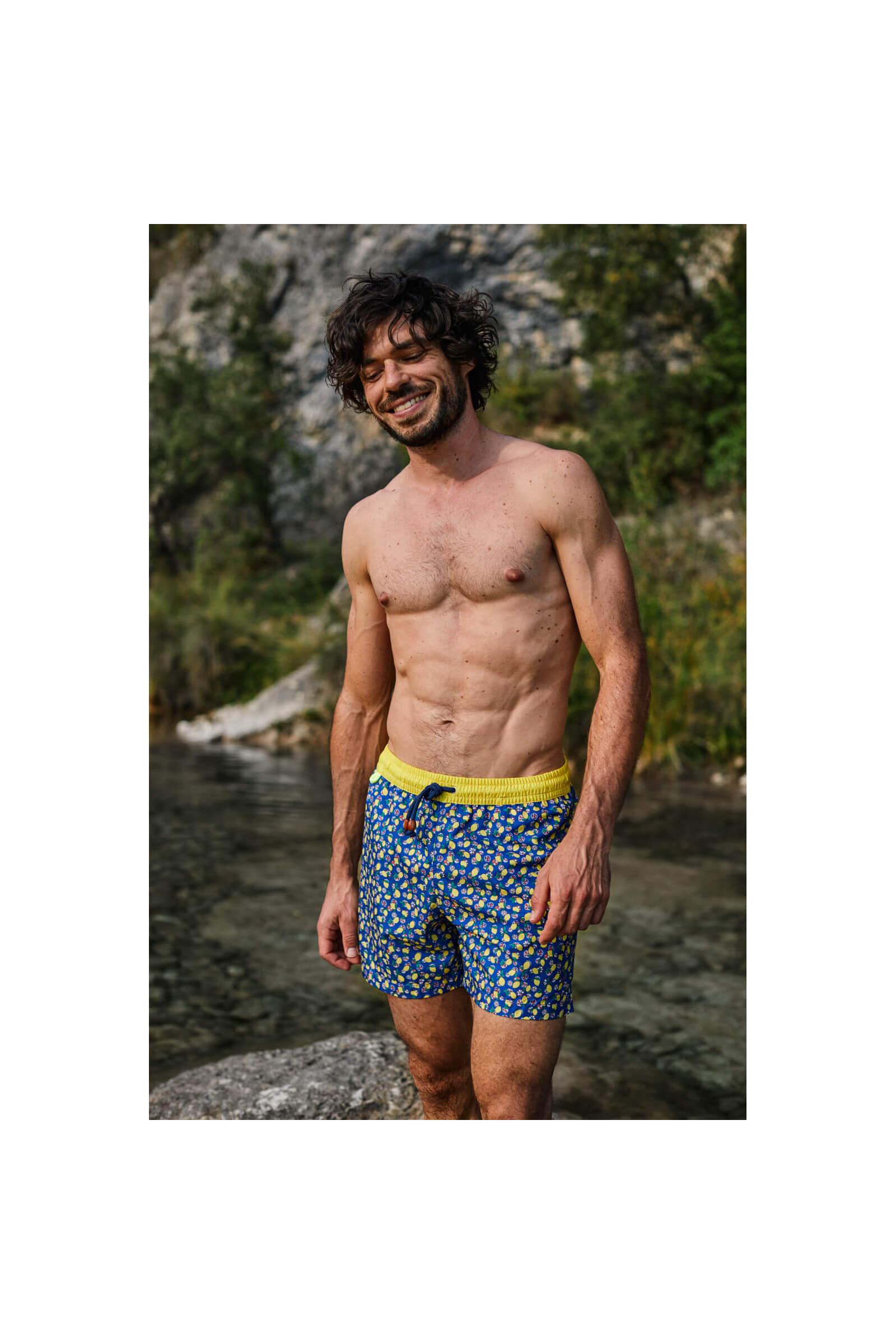 Man wearing a Lemonade swimsuit with elasticated belt