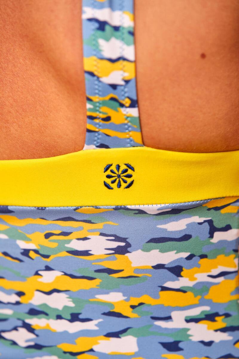 Woman wearing a one-piece swimsuit Pâquerettes GILI'S x EMOI EMOI