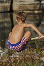 Boy wearing a swimsuit with elasticated belt Meno La Baule