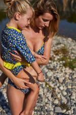 baby girl wearing a Lemonade bikini bottom