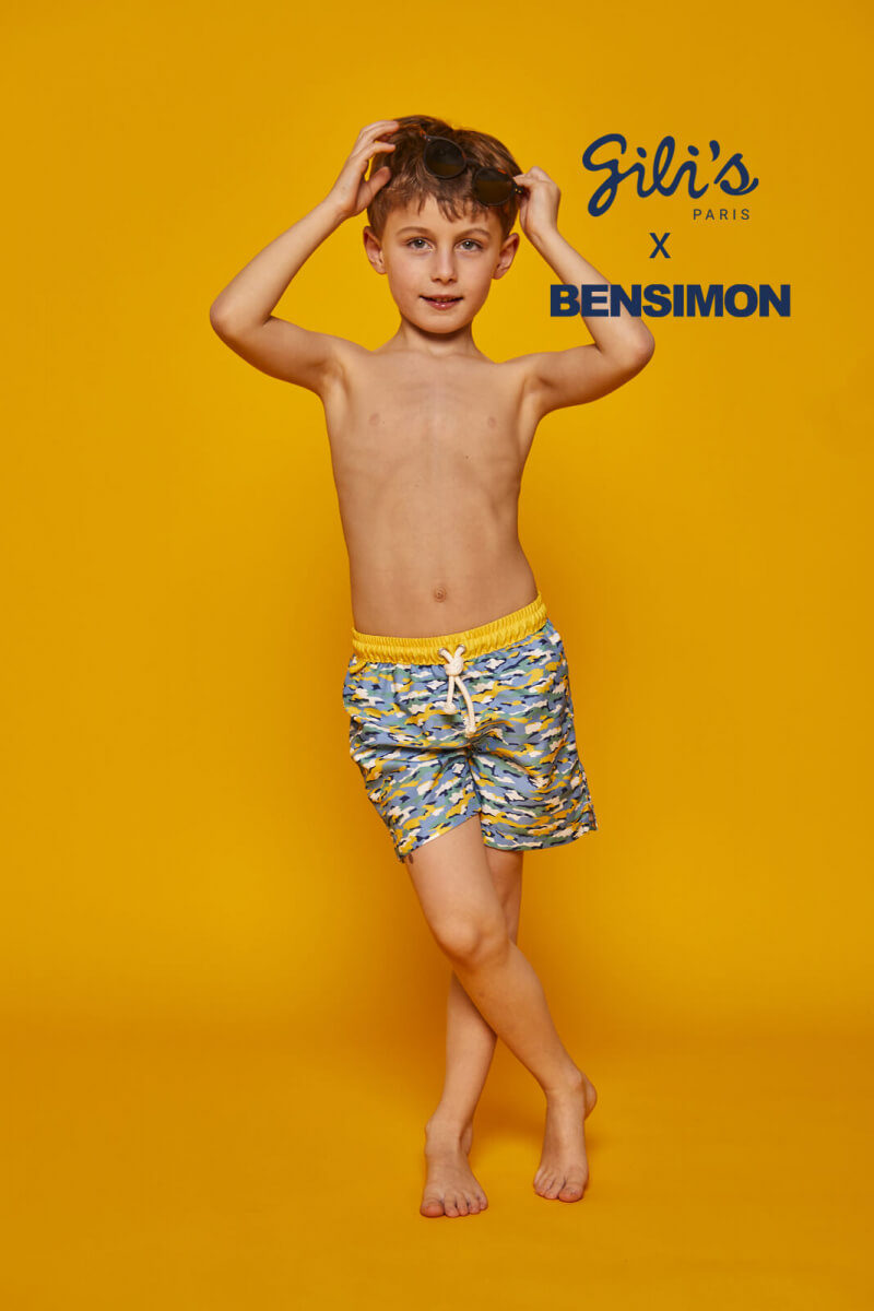 Boy wearing a swimsuit with buttoned belt Meno Camouflage GILI'S x BENSIMON