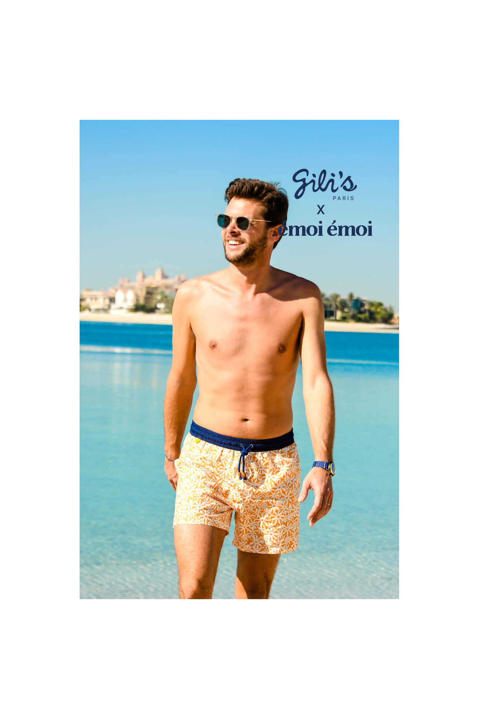 Man wearing a Pâquerettes GILI'S x EMOI EMOI swimsuit with elasticated belt