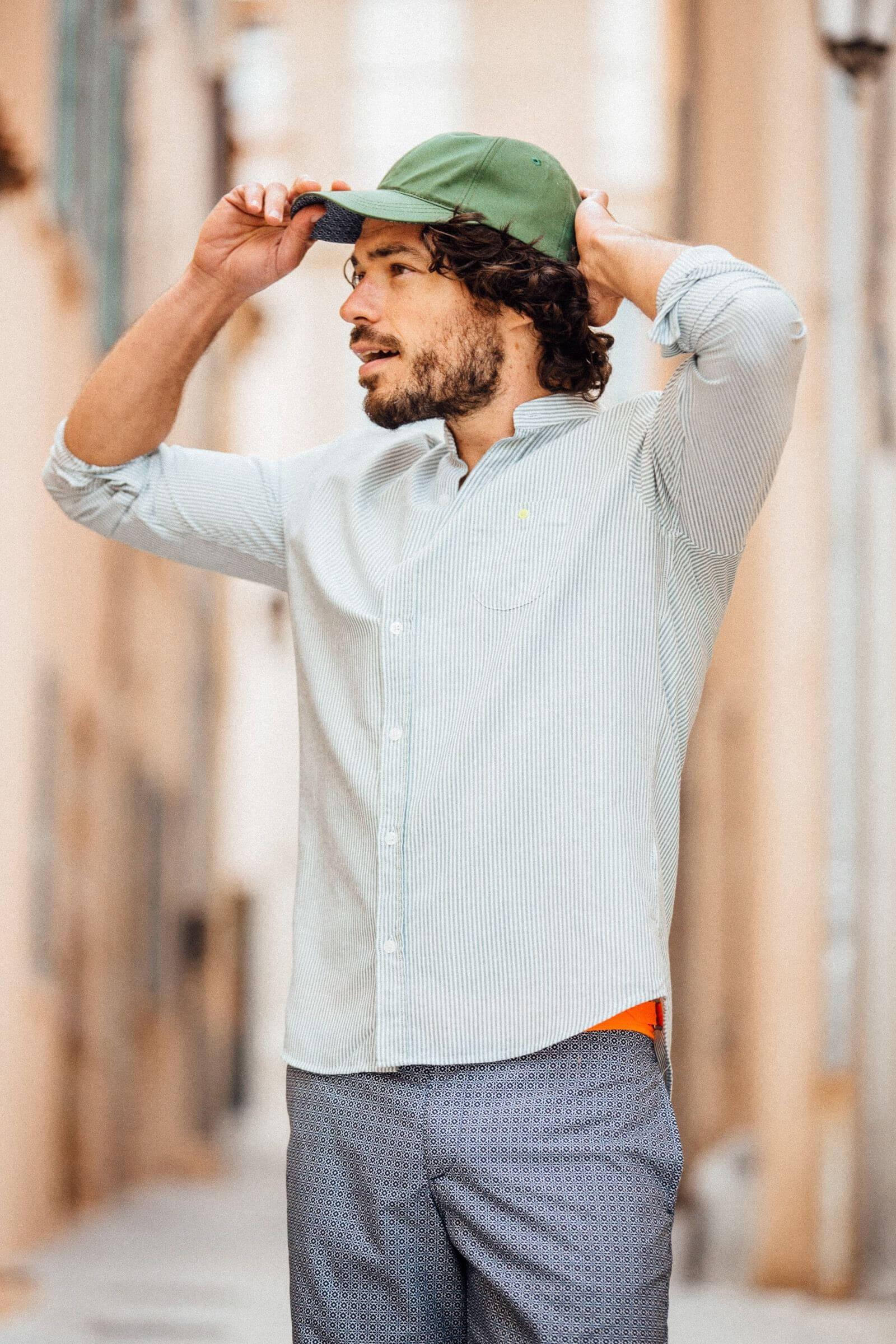 man wearing a khaki striped mandarin collar shirt