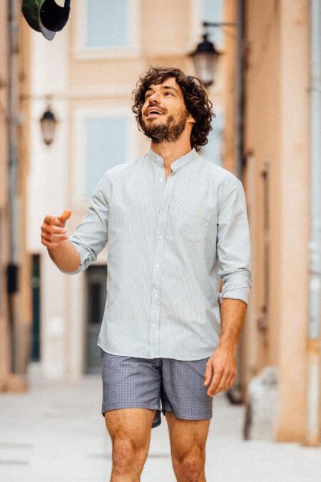 man wearing a khaki striped mandarin collar shirt 2